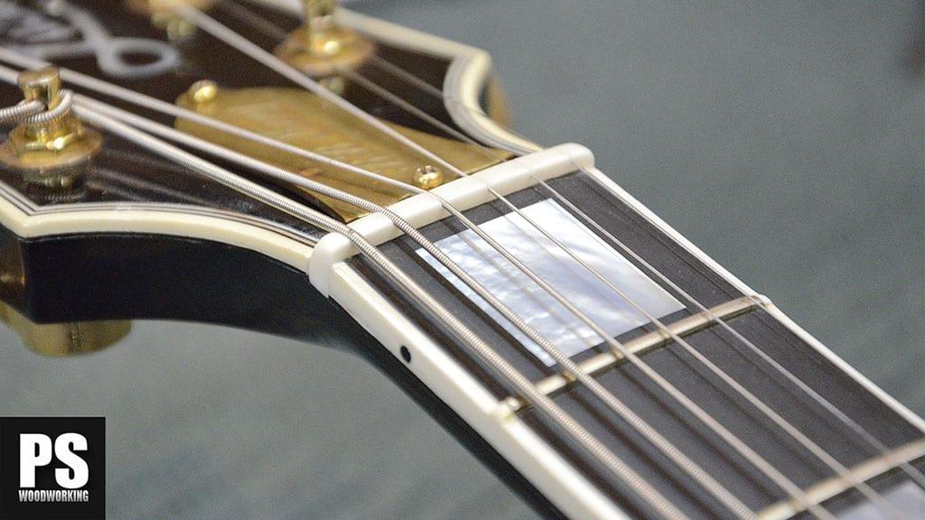 Cambio de cejuela en una Gibson Lucille